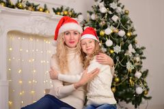 Mother and daughter New Year Christmas. Portrait of mother and daughter New Year Christmas Royalty Free Stock Photos