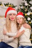 Mother and daughter New Year Christmas. Portrait of mother and daughter New Year Christmas Stock Image