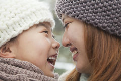 Mother and daughter nose to nose portrait Stock Photos
