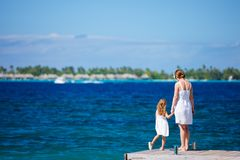 Mother and daughter at oceanfront Royalty Free Stock Photo