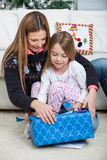 Mother And Daughter Opening Christmas Present Royalty Free Stock Photos