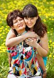 Mother with daughter in outdoor. Stock Image