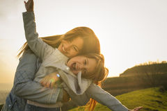 Mother with daughter outdoor. stock photos