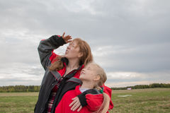 Mother and daughter outdoor and cloudy sky Stock Photos