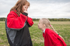 Mother and daughter outdoor and cloudy sky Royalty Free Stock Photography