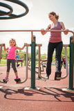 Mother and daughter outdoor exercise. Mother and daughter working exercise together stock images