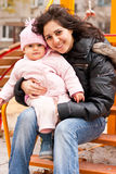 Mother and daughter outdoor on a playground Royalty Free Stock Photo