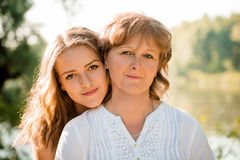 Mother and daughter outdoor portrait Stock Photos