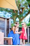 Mother and daughter at outdoor terrace Royalty Free Stock Images