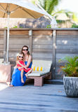 Mother and daughter at outdoor terrace Stock Image