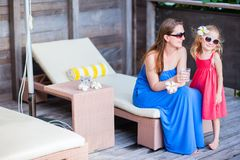 Mother and daughter at outdoor terrace Royalty Free Stock Photo
