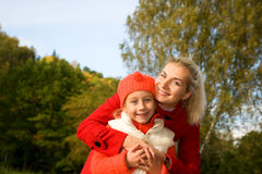 Mother and daughter outdoors Stock Photos