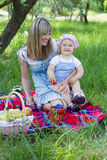 Mother with daughter outdoors Stock Photography
