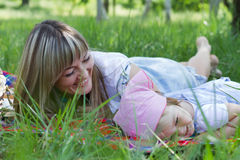 Mother with daughter outdoors Stock Image
