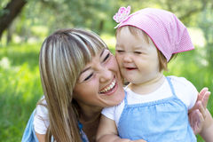 Mother with daughter outdoors Royalty Free Stock Image