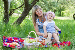 Mother with daughter outdoors Royalty Free Stock Photos