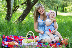 Mother with daughter outdoors Stock Photos