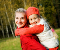 Mother and daughter outdoors Royalty Free Stock Photos