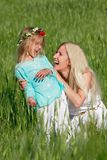 Mother and daughter outdoors Royalty Free Stock Photo