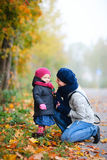 Mother and daughter outdoors on foggy day Royalty Free Stock Images