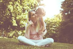 Mother and daughter outdoors in a meadow. Mother and daughter p royalty free stock image