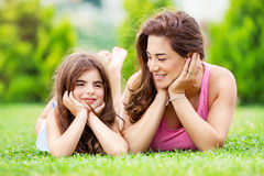 Mother with daughter outdoors stock photo