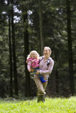 Mother and daughter (2-4) outdoors, smiling Royalty Free Stock Image