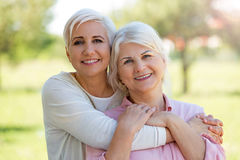 Mother and daughter. Outdoors, smiling Stock Images