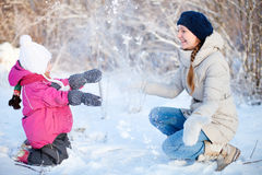 Mother and daughter outdoors at winter Royalty Free Stock Image