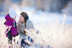 Mother and daughter outdoors at winter Stock Image