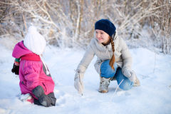 Mother and daughter outdoors at winter Royalty Free Stock Photos