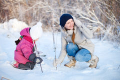 Mother and daughter outdoors at winter Royalty Free Stock Photography