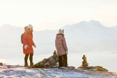 Mother and daughter outdoors on winter. Beautiful family of mother and daughter enjoying snowy winter day outdoors in Northern Norway Royalty Free Stock Photography