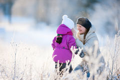 Mother and daughter outdoors on winter day Royalty Free Stock Photos