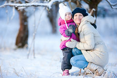 Mother and daughter outdoors on winter day Stock Photos