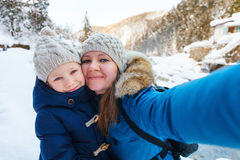 Mother and daughter outdoors at winter Stock Images