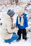 Mother and daughter outdoors on winter Royalty Free Stock Image