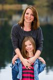 Mother and Daughter outside at a lake Royalty Free Stock Images