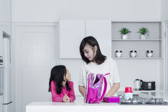 Mother and daughter packing lunch in the kitchen Royalty Free Stock Photos