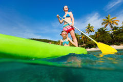 Mother and daughter paddling Stock Image