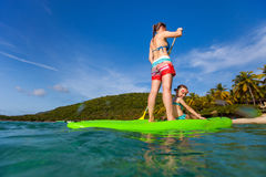 Mother and daughter paddling Royalty Free Stock Photos
