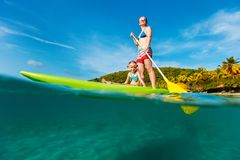 Mother and daughter paddling stock photography
