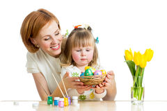 Mother and daughter paint easter eggs. Mother and baby kid painting easter eggs Stock Photo