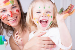 Mother and daughter with paint on faces Stock Photo