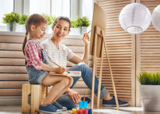 Mother and daughter paint royalty free stock photo