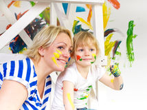 Mother and daughter paint. Mom and daughter paint colors Royalty Free Stock Images