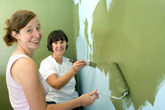Mother and Daughter Painting. Stock Photos