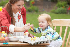 Mother And Daughter Painting Easter Eggs Stock Photo