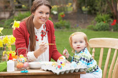 Mother And Daughter Painting Easter Eggs Royalty Free Stock Photography