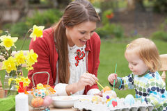Mother And Daughter Painting Easter Eggs Stock Image